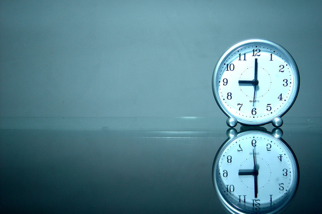 off-peak hours - Clock and its reflection with reference to the double rate
